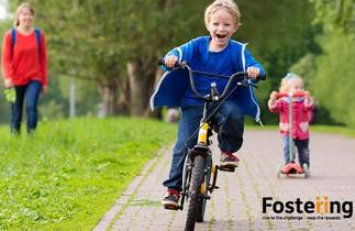 Fostering boy on bike