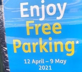 Free parking sign on machine