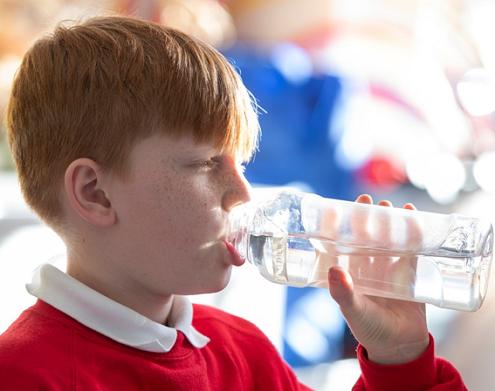 Schoolboy drinking water