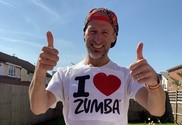 Greg wearing I love Zumba top with his thumbs up