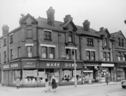A black and white photo of a Withington street in the 60's