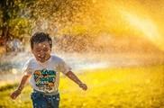 Boy being splashed