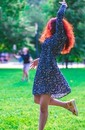 Dancing woman in park