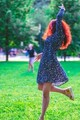 Dancing woman in park