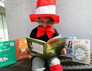 Child reading Dr. Seuss