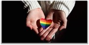 Rainbow heart in hands photo