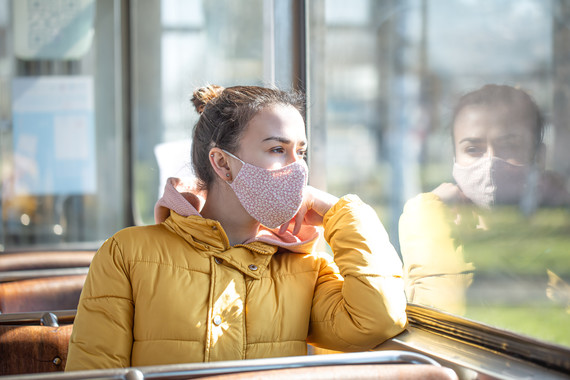 A young woman on public transport during the pandemic. stock photo
