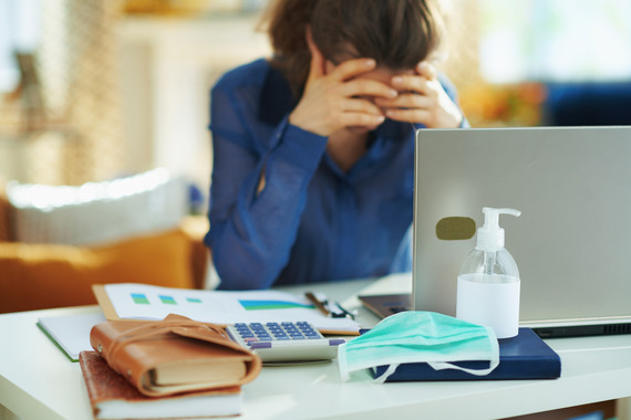 iStock image of person sat at desk looking stressed