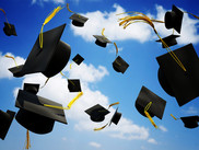 Mortar boards being thrown into the air