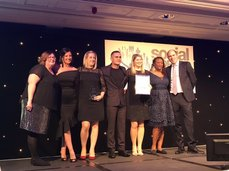 Image of the Social Work Team receiving the award