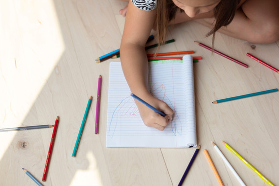Child drawing on a notepad