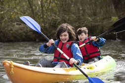 Images of young people kayaking
