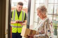 Lady receiving parcel at the door