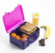purple lunch box with sandwiches, fruit and a cup of orange juice