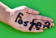 Hands with the word foster written on them