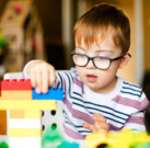 Photo of child playing with building blocks
