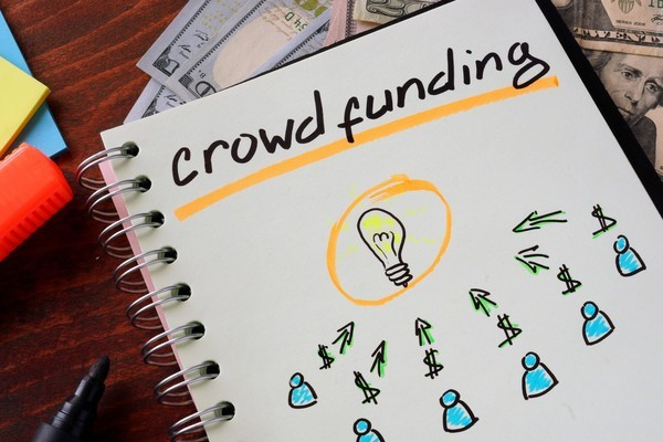 crowdfunding words on a notepad