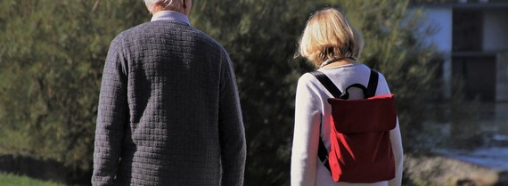 Older person walking in a garden