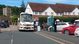Church Stretton Shuttle Bus outside the Coop