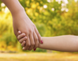 parent and child holding hands
