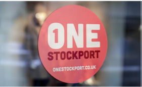 One Stockport Logo in a Window