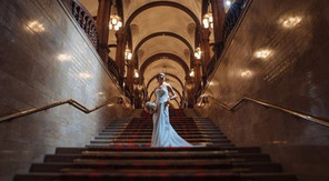 Image of bride standing on the staircase in County Buildings, Stafford.