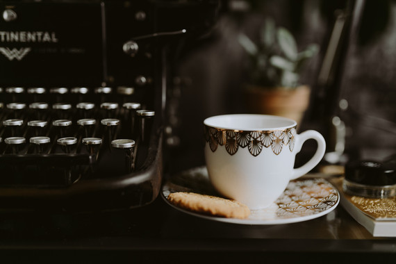 Type writer and tea cup