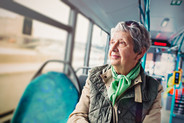 Image of elderly lady on bus.