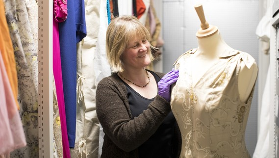 Helen Johnson working with the museum dress collection