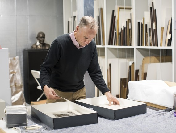 Chris Copp looking at the photograph collection in the museum stores