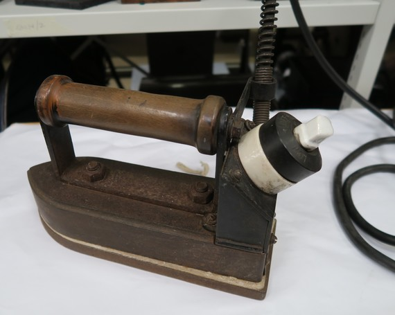 Electric iron used in the laundry at St Edwards Hospital, Cheddleton