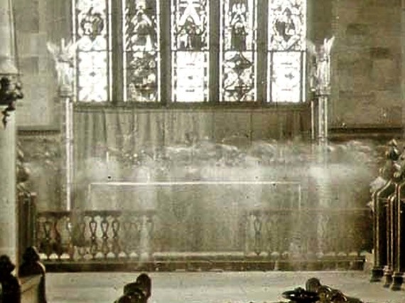 Image of ghostly figures in front of the alter at Checkley Church
