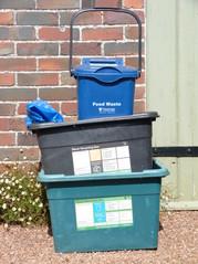 stacked bins by garage door
