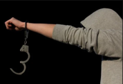 young person with handcuffs