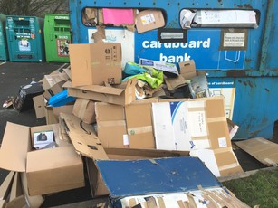 Waste dumped outside recycling containers