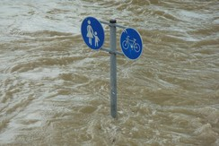 flood with only directional signs above the water