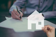 Image of someone signing a document with a house image hovering above the paper