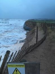 Dawlish Warren dune footpath closure with beach and sea in background