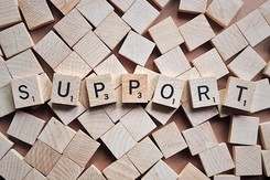 SUPPORT in scrabble letters