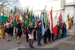 People carrying different flags from commonwealth countries