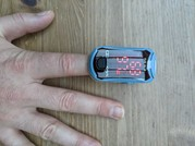 'early warning system' device shown on a person's finger