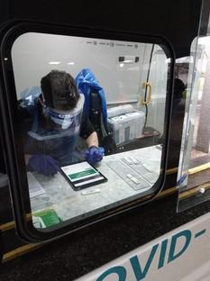 Covid mobile testing van showing individual inside