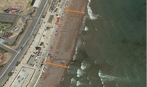 Aerial view of Teignmouth beach showing the groynes that are being repaired