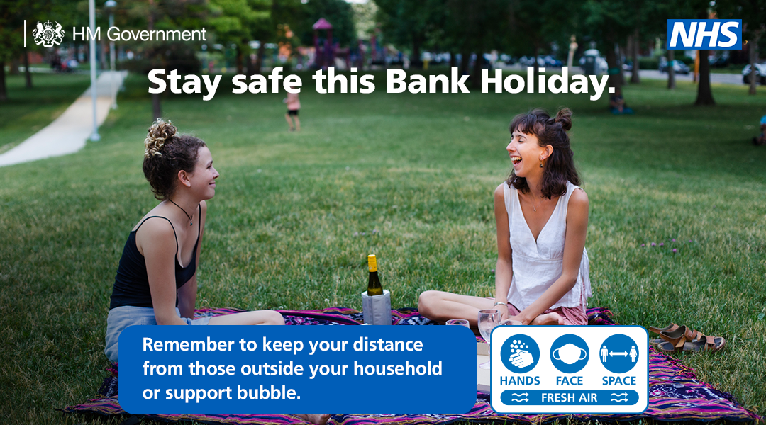 Picnic scene with message - Stay safe this bank holiday.  Remember to keep your distance from those outside your household or your support bubble