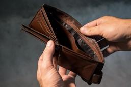 hands opening an empty wallet/purse