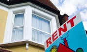 Image of a house with a for rent sign outside