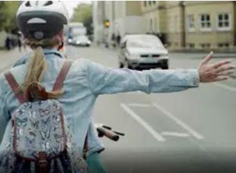 girl cycling to school
