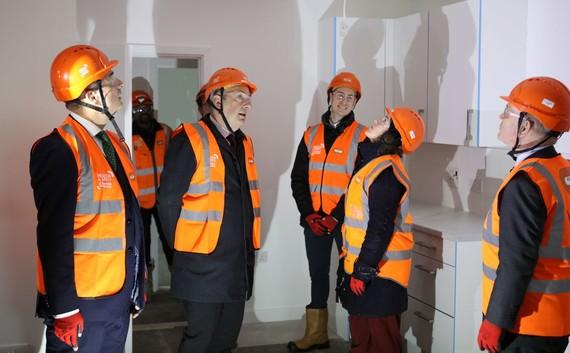 Chris Stevens, David allows, Councillor Rachel Blake and Mayor John Biggs viewing the interior of a new build home.