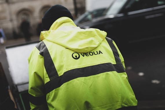 Person in Veolia uniform collecting bins