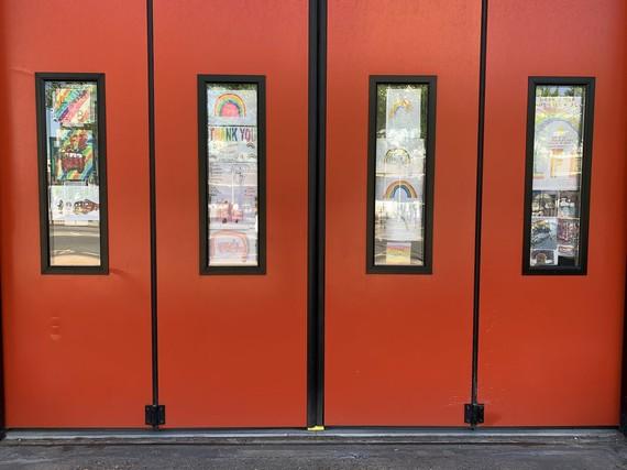 Popar fire station windows covered in rainbow artwork